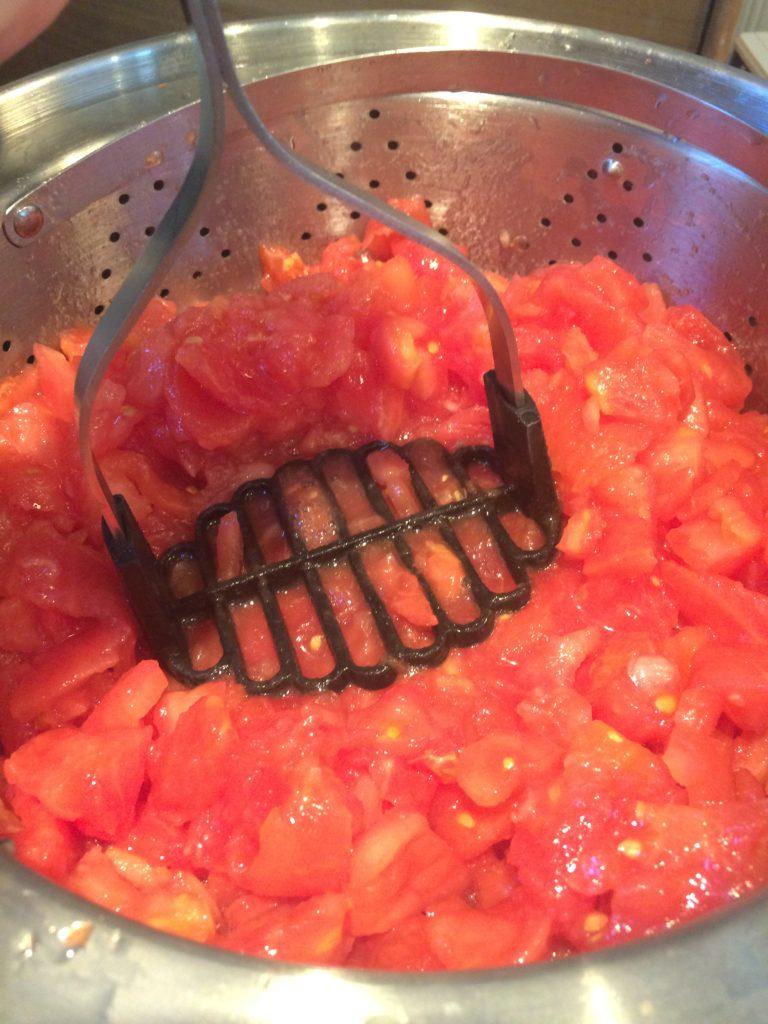Crushing tomatoes for spaghetti sauce